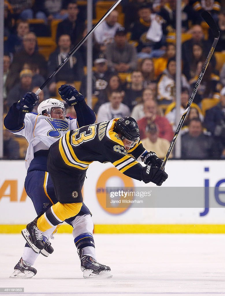Brad Marchand of the Boston Bruins hits Ian Cole of the St Louis Blues in the second period at TD Garden on November 21 2013 in Boston Massachusetts