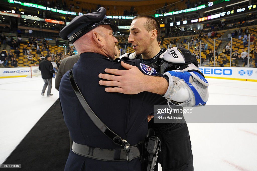 <a gi-track='captionPersonalityLinkClicked' href=/galleries/search?phrase=Brad+Marchand&family=editorial&specificpeople=2282544 ng-click='$event.stopPropagation()'>Brad Marchand</a> #63 of the Boston Bruins hugs with one of the first responders from the Boston Marathon tragedy after the game against the Florida Panthers at the TD Garden on April 21, 2013 in Boston, Massachusetts.