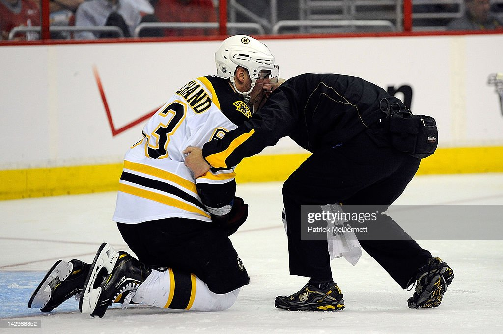 <a gi-track='captionPersonalityLinkClicked' href=/galleries/search?phrase=Brad+Marchand&family=editorial&specificpeople=2282544 ng-click='$event.stopPropagation()'>Brad Marchand</a> #63 of the Boston Bruins is attended to by the trainer during the third period against the Washington Capitals in Game Three of the Eastern Conference Quarterfinals during the 2012 NHL Stanley Cup Playoffs at Verizon Center on April 16, 2012 in Washington, DC.