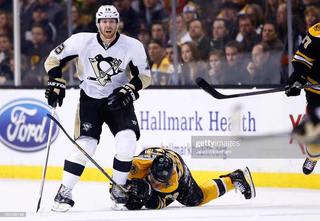 <a gi-track='captionPersonalityLinkClicked' href=/galleries/search?phrase=Brad+Marchand&family=editorial&specificpeople=2282544 ng-click='$event.stopPropagation()'>Brad Marchand</a> #63 of the Boston Bruins is kneed in the head by <a gi-track='captionPersonalityLinkClicked' href=/galleries/search?phrase=James+Neal&family=editorial&specificpeople=1487991 ng-click='$event.stopPropagation()'>James Neal</a> #18 of the Pittsburgh Penguins in the first period during the game at TD Garden on December 7, 2013 in Boston, Massachusetts. Neal would receive a penalty for the hit.
