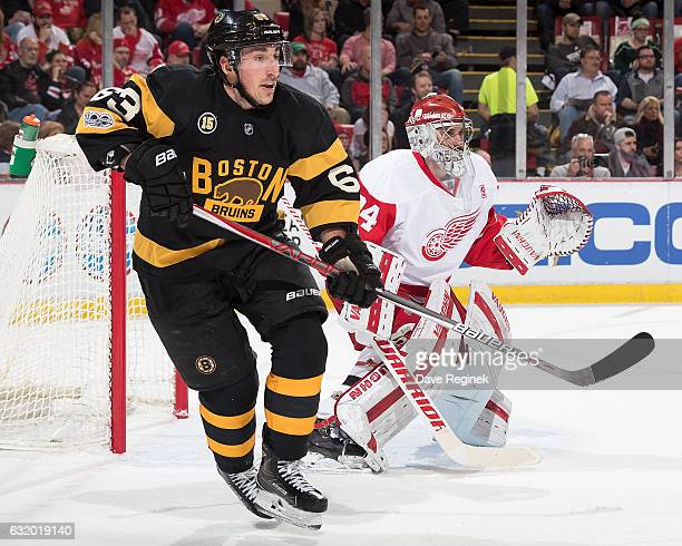 Brad Marchand of the Boston Bruins looks for a pass in front of goaltender Petr Mrazek of the Detroit Red Wings during an NHL game at Joe Louis Arena...