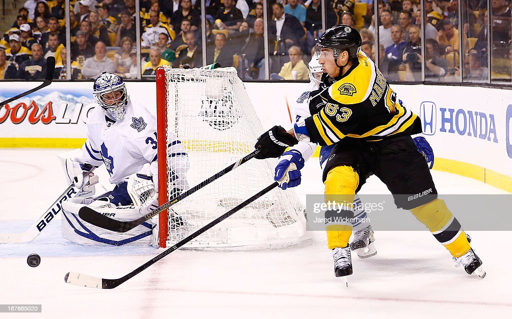 <a gi-track='captionPersonalityLinkClicked' href=/galleries/search?phrase=Brad+Marchand&family=editorial&specificpeople=2282544 ng-click='$event.stopPropagation()'>Brad Marchand</a> #63 of the Boston Bruins makes a pass in front of the net past James Reimer #34 of the Toronto Maple Leafs in Game One of the Eastern Conference Quarterfinals during the 2013 NHL Stanley Cup Playoffs on May 1, 2013 at TD Garden in Boston, Massachusetts.
