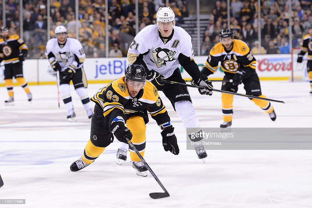 <a gi-track='captionPersonalityLinkClicked' href=/galleries/search?phrase=Brad+Marchand&family=editorial&specificpeople=2282544 ng-click='$event.stopPropagation()'>Brad Marchand</a> #63 of the Boston Bruins reaches for the loose puck against <a gi-track='captionPersonalityLinkClicked' href=/galleries/search?phrase=Evgeni+Malkin&family=editorial&specificpeople=221676 ng-click='$event.stopPropagation()'>Evgeni Malkin</a> #71 of the Pittsburgh Penguins in Game Four of the Eastern Conference Final during the 2013 NHL Stanley Cup Playoffs at TD Garden on June 7, 2013 in Boston, Massachusetts.