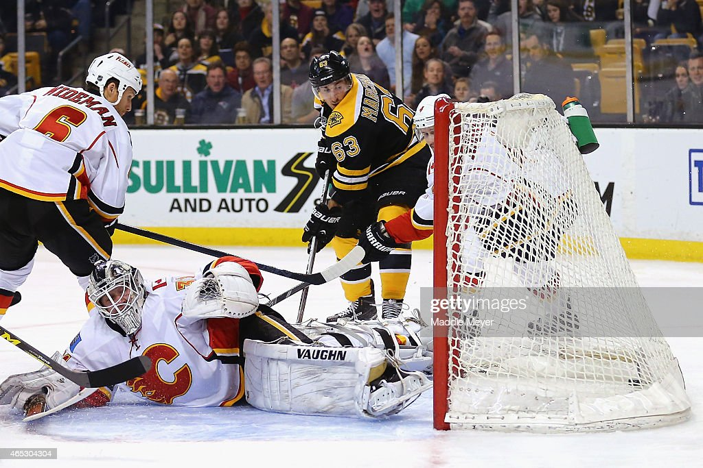 Brad Marchand of the Boston Bruins scores a goal against Karri Ramo of the Calgary Flames during the first period at TD Garden on March 5 2015 in...