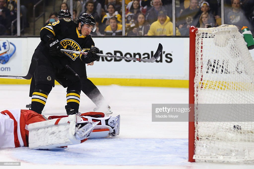 <a gi-track='captionPersonalityLinkClicked' href=/galleries/search?phrase=Brad+Marchand&family=editorial&specificpeople=2282544 ng-click='$event.stopPropagation()'>Brad Marchand</a> #63 of the Boston Bruins scores a goal in the first period against the Detroit Red Wings at TD Garden on March 8, 2015 in Boston, Massachusetts.