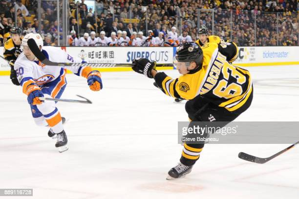 Brad Marchand of the Boston Bruins scores a goal in the second period against the New York Islanders at the TD Garden on December 9 2017 in Boston...