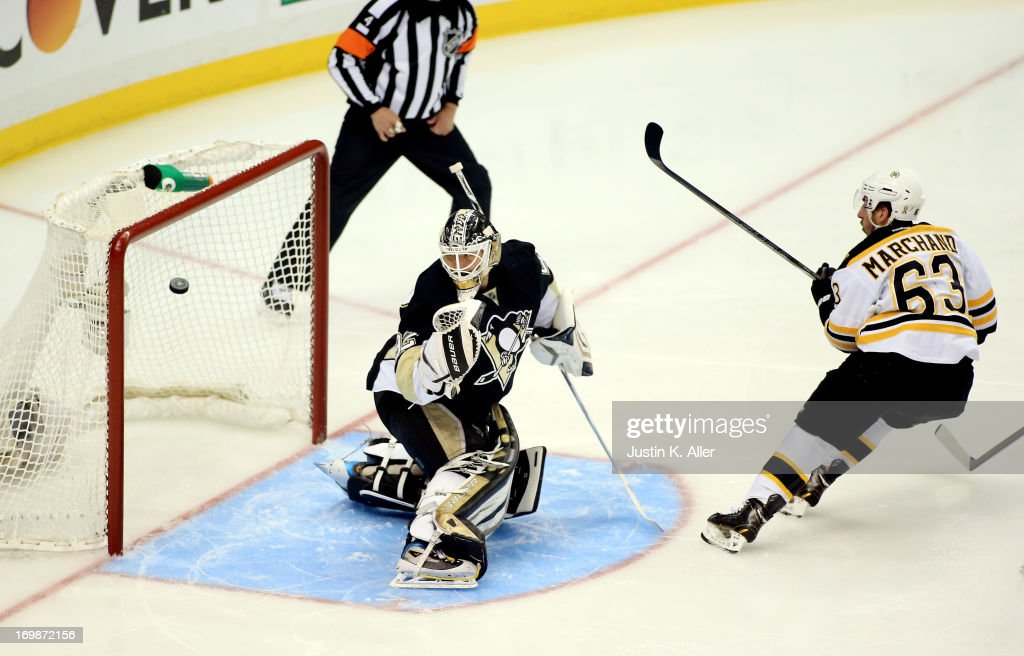 Brad Marchand of the Boston Bruins scores a goal on Tomas Vokoun of the Pittsburgh Penguins in the first period during Game Two of the Eastern...