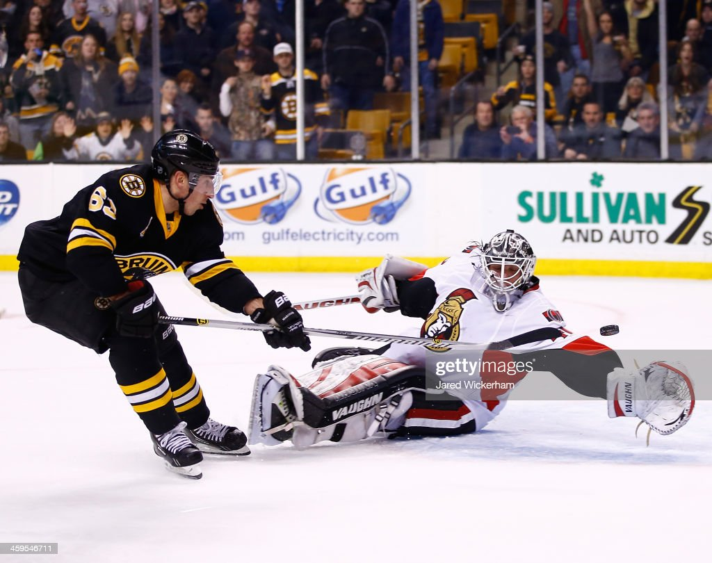 <a gi-track='captionPersonalityLinkClicked' href=/galleries/search?phrase=Brad+Marchand&family=editorial&specificpeople=2282544 ng-click='$event.stopPropagation()'>Brad Marchand</a> #63 of the Boston Bruins scores a shorthanded goal past <a gi-track='captionPersonalityLinkClicked' href=/galleries/search?phrase=Robin+Lehner&family=editorial&specificpeople=5894610 ng-click='$event.stopPropagation()'>Robin Lehner</a> #40 of the Ottawa Senators late in the third period during the game at TD Garden on December 27, 2013 in Boston, Massachusetts.