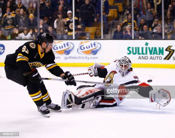 Brad Marchand of the Boston Bruins scores a shorthanded goal past Robin Lehner of the Ottawa Senators late in the third period during the game at TD...
