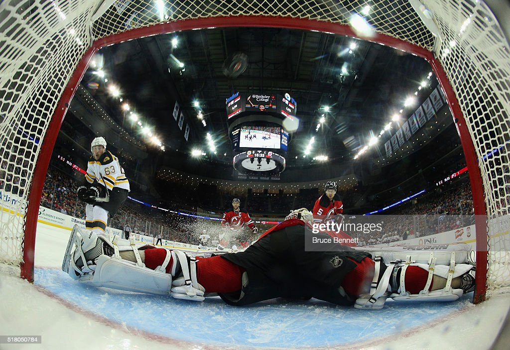 <a gi-track='captionPersonalityLinkClicked' href=/galleries/search?phrase=Brad+Marchand&family=editorial&specificpeople=2282544 ng-click='$event.stopPropagation()'>Brad Marchand</a> #63 of the Boston Bruins (l) scores at 4:28 of the second period over the head of <a gi-track='captionPersonalityLinkClicked' href=/galleries/search?phrase=Keith+Kinkaid&family=editorial&specificpeople=7645382 ng-click='$event.stopPropagation()'>Keith Kinkaid</a> #1 of the New Jersey Devils at the Prudential Center on March 29, 2016 in Newark, New Jersey.