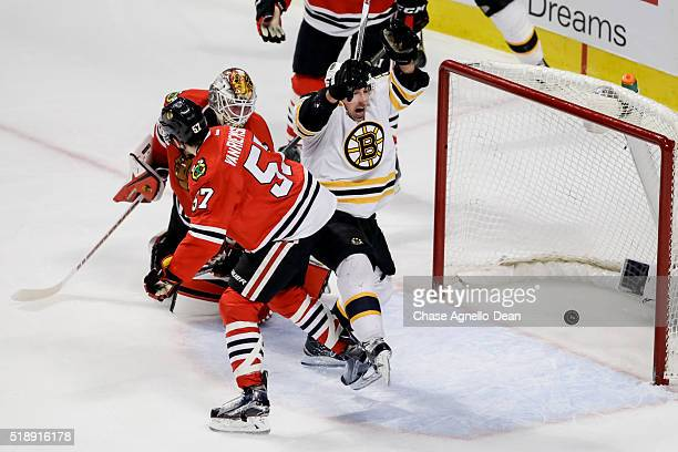 Brad Marchand of the Boston Bruins scores on goalie Scott Darling of the Chicago Blackhawks in the third period of the NHL game at the United Center...