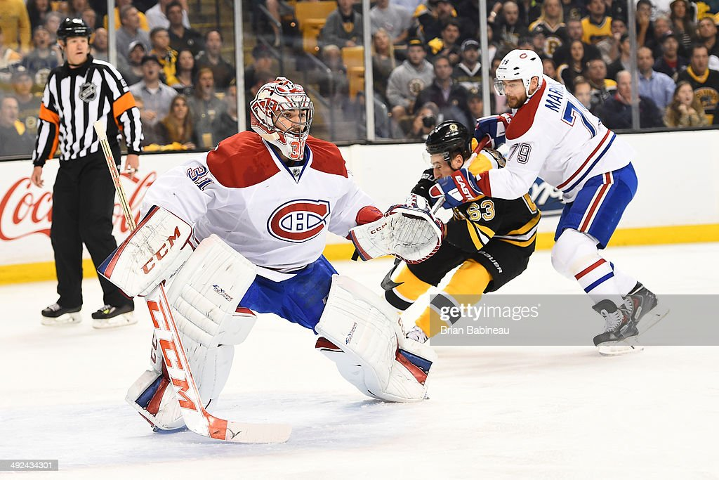 Brad Marchand #63 of the Boston Bruins skates against Carey Price #31 and Andrei Markov #79 of the Montreal Canadiens in Game Seven of the Second Round of the 2014 Stanley Cup Playoffs at TD Garden on May 14, 2014 in Boston, Massachusetts.