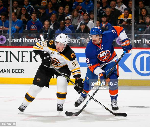 Brad Marchand of the Boston Bruins skates against Travis Hamonic of the New York Islanders during the second period at the Barclays Center on March...