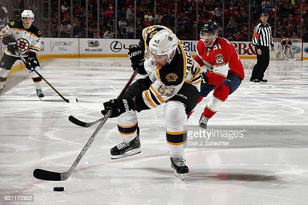 Brad Marchand of the Boston Bruins skates with the puck against Greg McKegg of the Florida Panthers at the BBT Center on January 7 2017 in Sunrise...