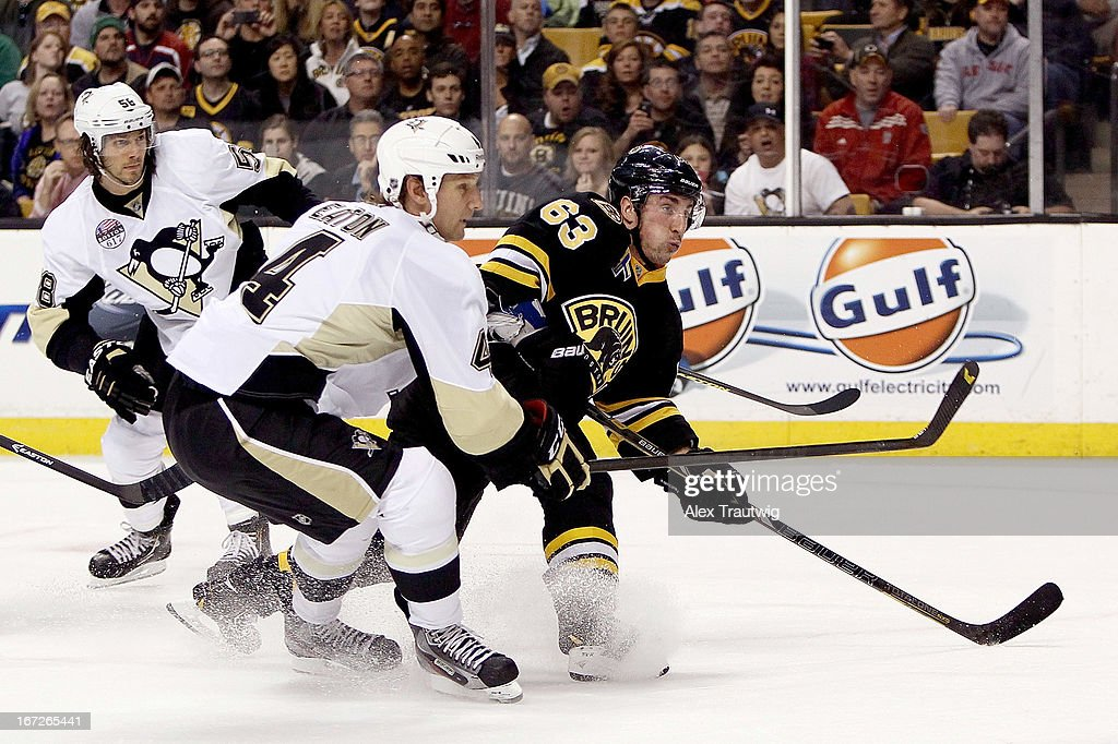 Brad Marchand #63 of the Boston Bruins takes a shot as Mark Eaton #4 of the Pittsburgh Penguins defends at the TD Garden on April 20, 2013 in Boston, Massachusetts.