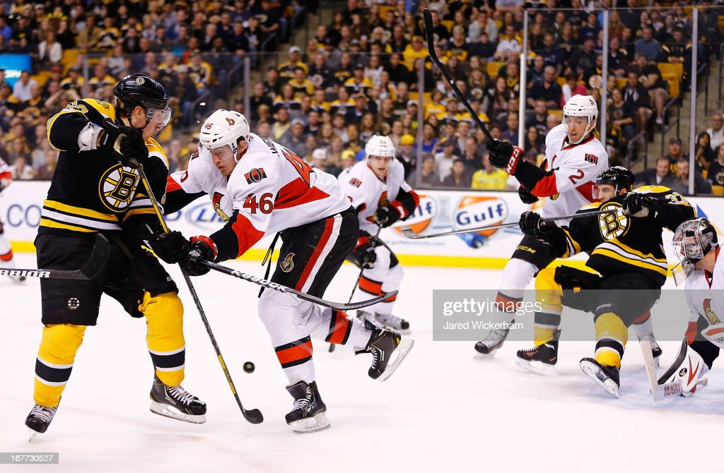 Brad Marchand #63 of the Boston Bruins takes a shot on goal in front of Patrick Wiercioch #46 of the Ottawa Senators during the game on April 28, 2013 at TD Garden in Boston, Massachusetts.