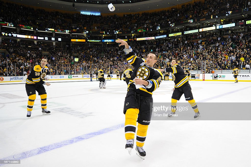 <a gi-track='captionPersonalityLinkClicked' href=/galleries/search?phrase=Brad+Marchand&family=editorial&specificpeople=2282544 ng-click='$event.stopPropagation()'>Brad Marchand</a> #63 of the Boston Bruins tosses a t shirt out to the fans after the game against the Florida Panthers at the TD Garden on April 21, 2013 in Boston, Massachusetts.
