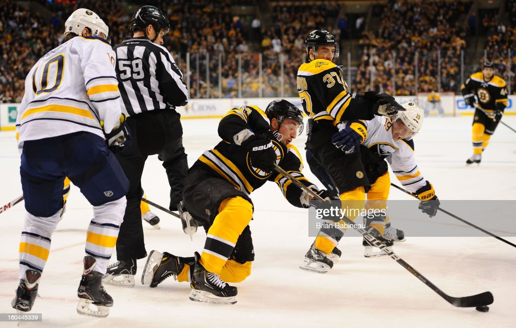 <a gi-track='captionPersonalityLinkClicked' href=/galleries/search?phrase=Brad+Marchand&family=editorial&specificpeople=2282544 ng-click='$event.stopPropagation()'>Brad Marchand</a> #63 of the Boston Bruins tries to handle the puck against the Buffalo Sabres at the TD Garden on January 31, 2013 in Boston, Massachusetts.