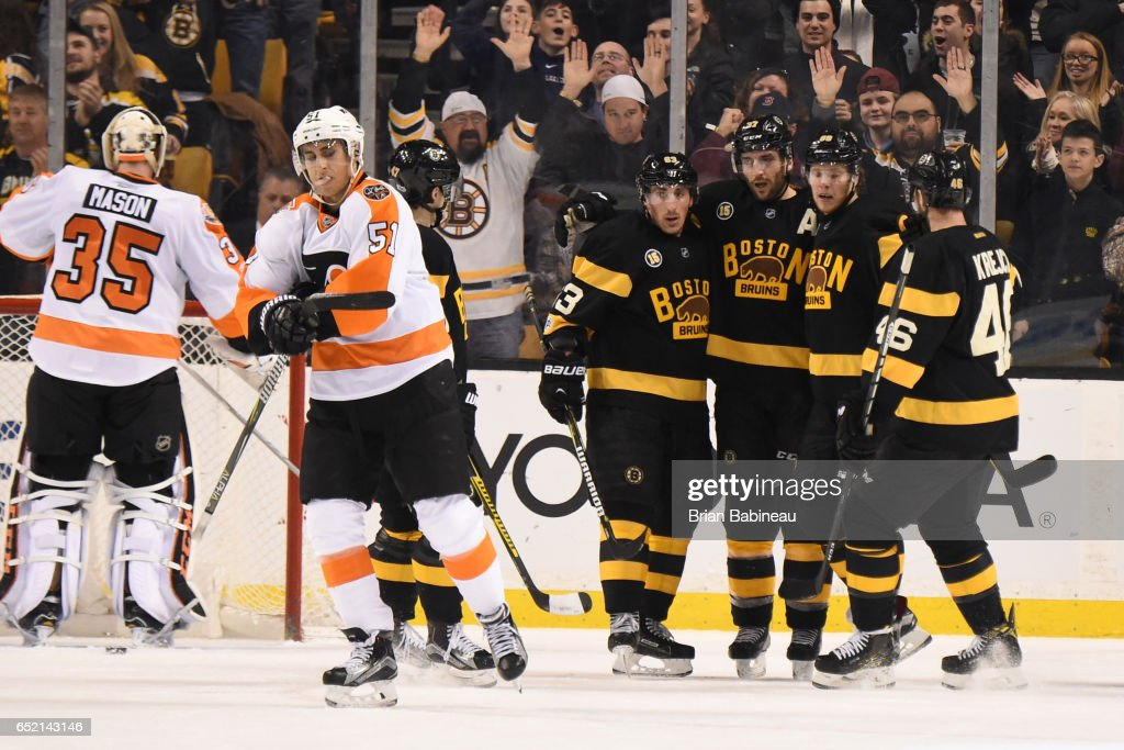 Brad Marchand #63, Patrice Bergeron #37, David Pastrnak #88 and David Krejci #46 of the Boston Bruins celebrate a goal against the Philadelphia Flyers at the TD Garden on March 11, 2017 in Boston, Massachusetts.