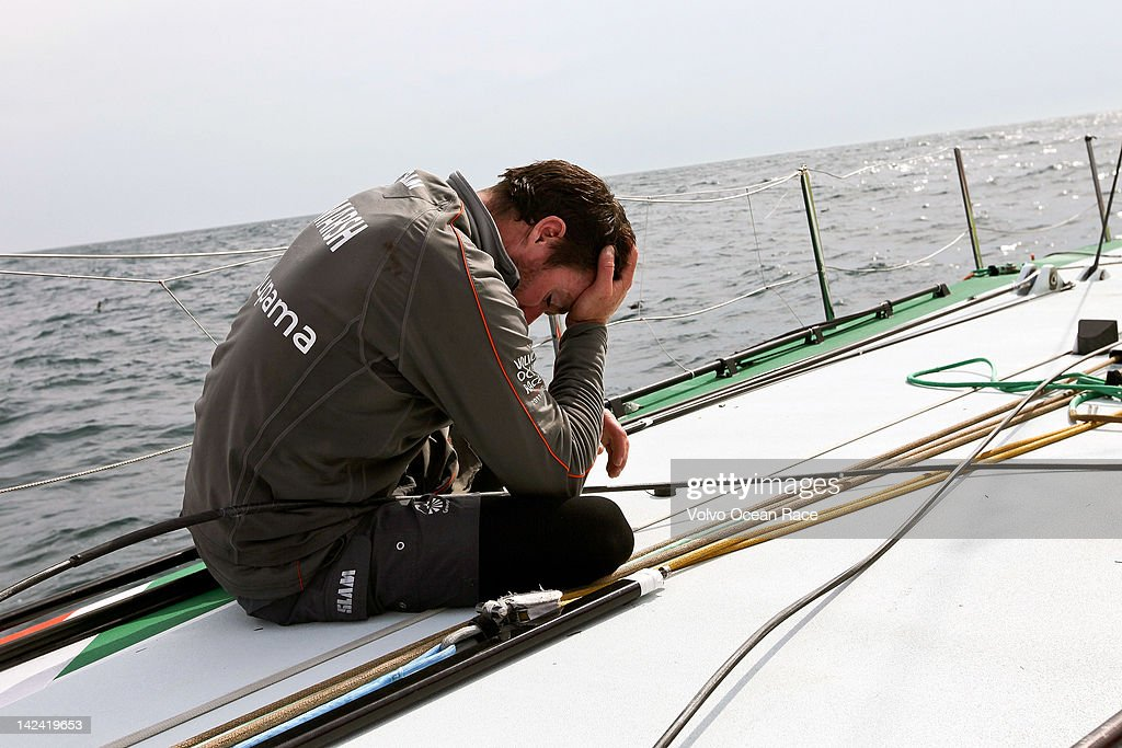 Brad Marsh from New Zealand sinks his head into his hand. Groupama Sailing Team, skippered by Franck Cammas from France, suspend racing from leg 5 of the Volvo Ocean Race 2011-12, from Auckland, New Zealand to Itajai, Brazil, after the mast broke just above the first spreader on April 4, 2012 around 60 nautical miles south of Punta del Este, Uruguay.