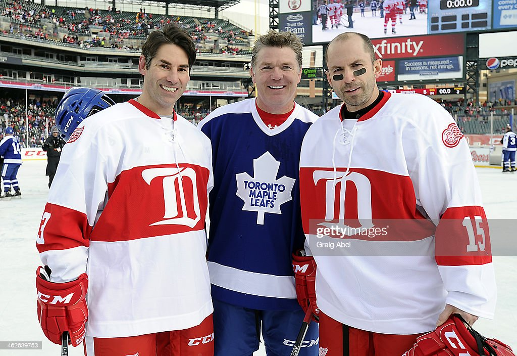 <a gi-track='captionPersonalityLinkClicked' href=/galleries/search?phrase=Brad+May&family=editorial&specificpeople=212874 ng-click='$event.stopPropagation()'>Brad May</a> #10 of the Toronto Maple Leafs Alumni with <a gi-track='captionPersonalityLinkClicked' href=/galleries/search?phrase=Mathieu+Schneider&family=editorial&specificpeople=206348 ng-click='$event.stopPropagation()'>Mathieu Schneider</a> #23 and <a gi-track='captionPersonalityLinkClicked' href=/galleries/search?phrase=Jason+Woolley&family=editorial&specificpeople=208207 ng-click='$event.stopPropagation()'>Jason Woolley</a> #15 of the Detroit Red Wings Alumni take time for a photo after the game on December 31, 2013 at Comerica Park in Detroit, Michigan.