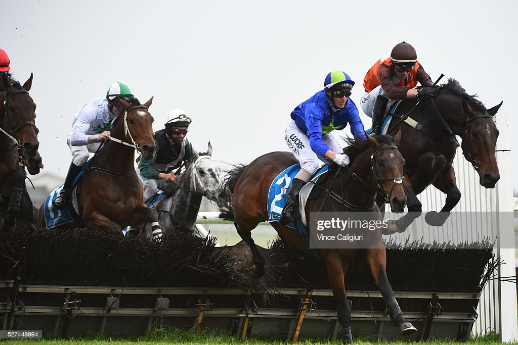 Brad McLean riding Attachment and Clayton Douglas riding Fionn McCool clear the second last hurdle in Race 3, the George Taylor Memorial Hurdle during Brierly Day at Warrnambool Race Club on May 3, 2016 in Warrnambool, Australia.