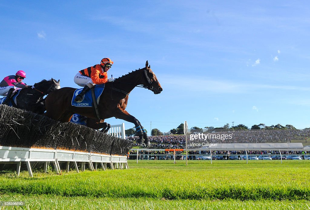 Brad McLean riding Mannertone leads the field in Race 7, Grand Annual Steeplechase during Grand Annual Day at Warrnambool Race Club on May 5, 2016 in Warrnambool, Australia. The race was won by Richard Cully riding No Song No Supper for trainer Pat Payne