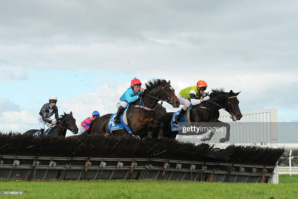 Brad McLean riding Tusan Fire (r) and Paul Hamblin riding Stand To Gain in Race 6, the Galleywood Hurdle during Brierly Day at Warrnambool Race Club on May 4, 2016 in Warrnambool, Australia. The race was won by Gingerboy.