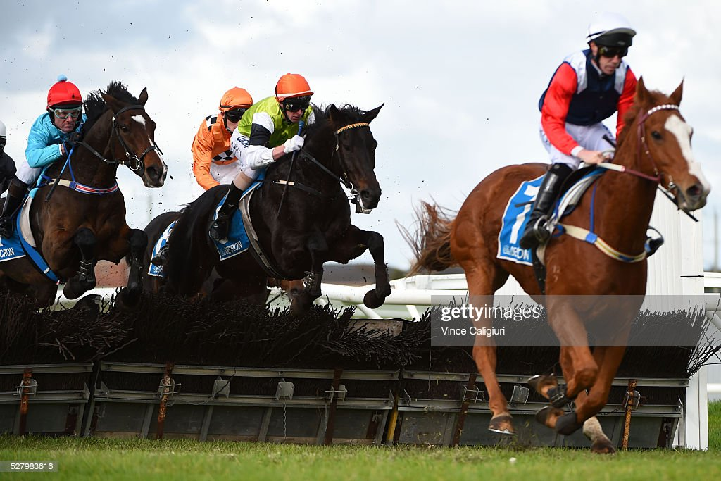 Brad McLean riding Tusan Fire (ctr) in Race 6, the Galleywood Hurdle during Brierly Day at Warrnambool Race Club on May 4, 2016 in Warrnambool, Australia. The race was won by Gingerboy (r).