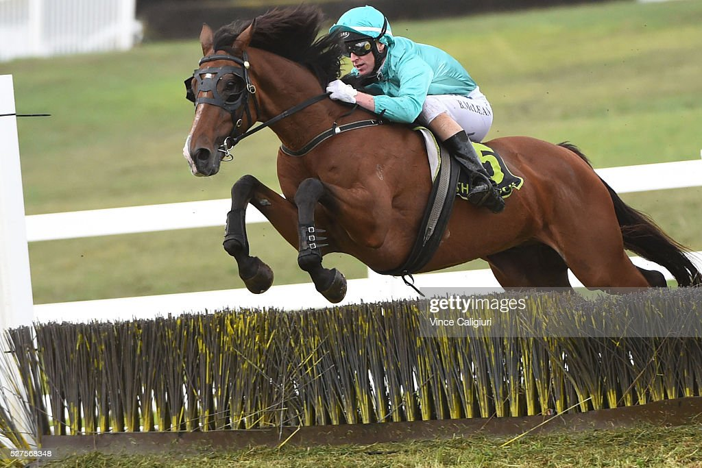 Brad McLean riding Valediction jumping the Tozer Road double before winning Race 6, the Brierly Steeplechase during Brierly Day at Warrnambool Race Club on May 3, 2016 in Warrnambool, Australia.