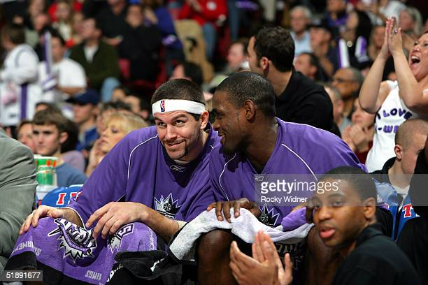 Brad Miller and Chris Webber of the Sacramento Kings sit on the bench during the game against the Miami Heat on December 23 at Arco Arena in...