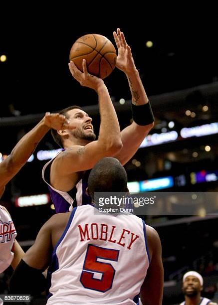 Brad Miller of the Sacramento Kings shoots over Cuttino Mobley of the Los Angeles Clippers on November 12 2008 at Staples Center in Los Angeles...