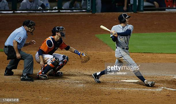 Brad Miller of the Seattle Mariners connects on a three run homer in the eighth inning against the Houston Astros at Minute Maid Park on July19 2013...