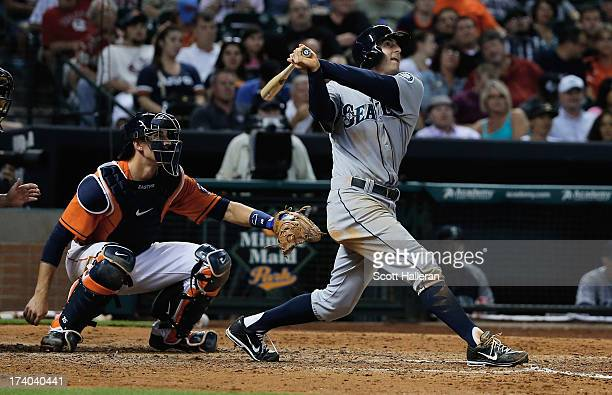 Brad Miller of the Seattle Mariners connects on a two run home run in the sixth inning against the Houston Astros at Minute Maid Park on July19 2013...