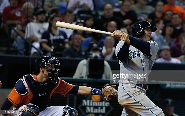 Brad Miller of the Seattle Mariners connects on a two run homer in the sixth inning against the Houston Astros at Minute Maid Park on July19 2013 in...