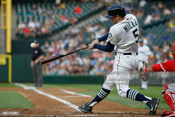 Brad Miller of the Seattle Mariners hits an RBI sacrifice fly against the Los Angeles Angels of Anaheim in the fourth inning at Safeco Field on July...