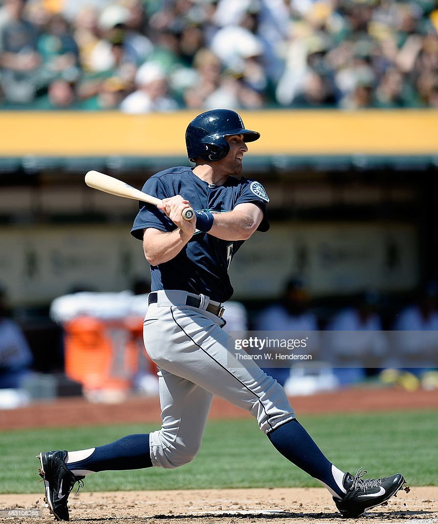 <a gi-track='captionPersonalityLinkClicked' href=/galleries/search?phrase=Brad+Miller+-+Baseball+Player&family=editorial&specificpeople=14752161 ng-click='$event.stopPropagation()'>Brad Miller</a> #5 of the Seattle Mariners hits an RBI single scoring Michael Saunders #55 (not pictured) against the Oakland Athletics in the top of the second inning at O.co Coliseum on April 6, 2014 in Oakland, California.