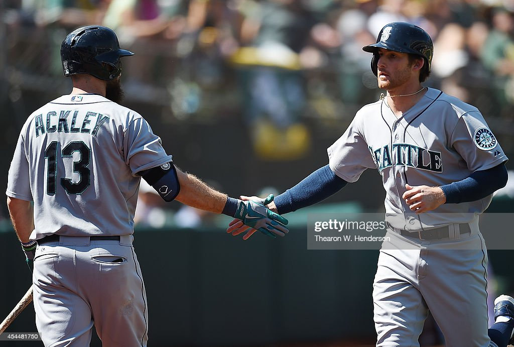 <a gi-track='captionPersonalityLinkClicked' href=/galleries/search?phrase=Brad+Miller+-+Baseball+Player&family=editorial&specificpeople=14752161 ng-click='$event.stopPropagation()'>Brad Miller</a> #5 of the Seattle Mariners is congratulated by <a gi-track='captionPersonalityLinkClicked' href=/galleries/search?phrase=Dustin+Ackley&family=editorial&specificpeople=4352278 ng-click='$event.stopPropagation()'>Dustin Ackley</a> #13 on his solo home run against the Oakland Athletics in the top of the six inning at O.co Coliseum on September 1, 2014 in Oakland, California.