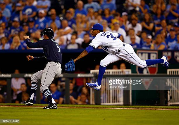 Brad Miller of the Seattle Mariners is tagged out by pitcher Yordano Ventura of the Kansas City Royals while running to first during the 3rd inning...