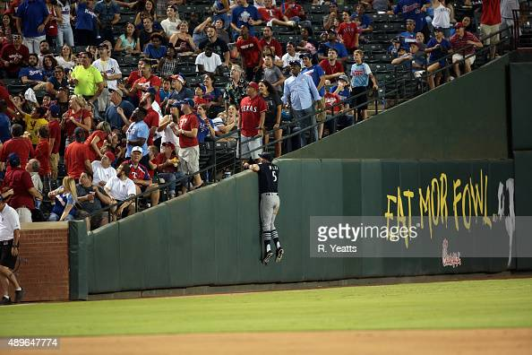 Brad Miller of the Seattle Mariners jumps for a foul ball in the seventh inning against the Texas Rangers at Global Life Park in Arlington on...
