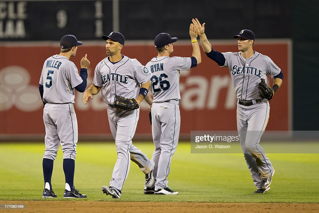 <a gi-track='captionPersonalityLinkClicked' href=/galleries/search?phrase=Brad+Miller+-+Baseball+Player&family=editorial&specificpeople=14752161 ng-click='$event.stopPropagation()'>Brad Miller</a> #5 of the Seattle Mariners, <a gi-track='captionPersonalityLinkClicked' href=/galleries/search?phrase=Raul+Ibanez&family=editorial&specificpeople=206118 ng-click='$event.stopPropagation()'>Raul Ibanez</a> #28, <a gi-track='captionPersonalityLinkClicked' href=/galleries/search?phrase=Brendan+Ryan&family=editorial&specificpeople=835643 ng-click='$event.stopPropagation()'>Brendan Ryan</a> #26, and Michael Saunders #55 celebrate after the game against the Oakland Athletics at O.co Coliseum on August 20, 2013 in Oakland, California. The Seattle Mariners defeated the Oakland Athletics 7-4.