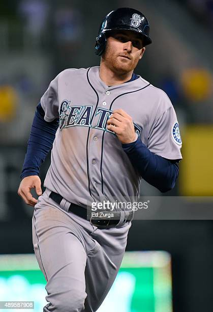 Brad Miller of the Seattle Mariners rounds third after hitting a home run in the third inning against the Kansas City Royals at Kauffman Stadium on...