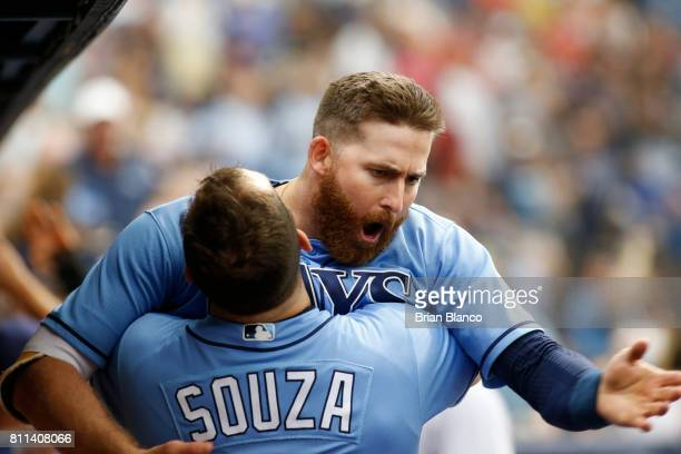 Brad Miller of the Tampa Bay Rays celebrates in the dugout with teammate Steven Souza Jr #20after hitting a tworun home run during the eighth inning...