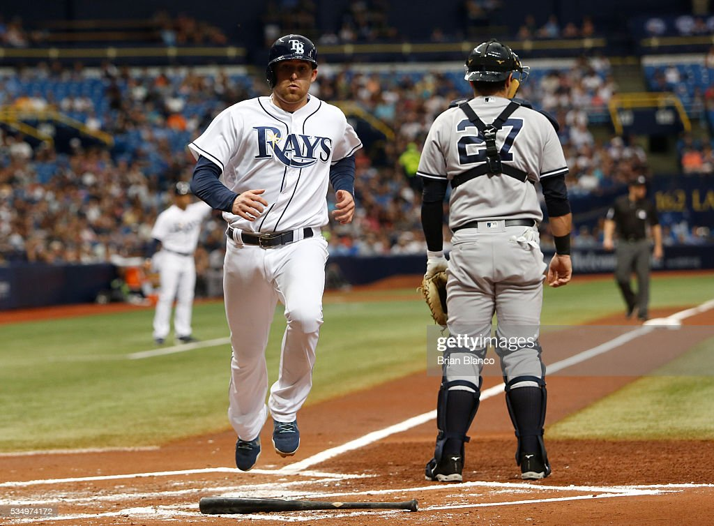 <a gi-track='captionPersonalityLinkClicked' href=/galleries/search?phrase=Brad+Miller+-+Baseball+Player&family=editorial&specificpeople=14752161 ng-click='$event.stopPropagation()'>Brad Miller</a> #13 of the Tampa Bay Rays crosses home plate in front of catcher Austin Romine #27 of the New York Yankees to score off of an infield single by Logan Morrison during the first inning of a game on May 28, 2016 at Tropicana Field in St. Petersburg, Florida.
