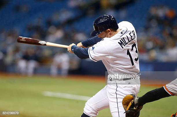 Brad Miller of the Tampa Bay Rays hits a double to left center field during the second inning of a game against the Baltimore Orioles on April 25...