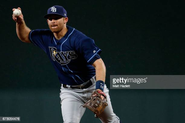 Brad Miller of the Tampa Bay Rays makes a throw to first base for the third out of the eighth inning against the Baltimore Orioles at Oriole Park at...