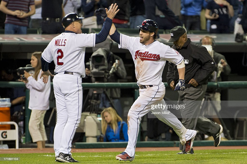 Brad Mills #2 celebrates with <a gi-track='captionPersonalityLinkClicked' href=/galleries/search?phrase=Jason+Kipnis&family=editorial&specificpeople=5330784 ng-click='$event.stopPropagation()'>Jason Kipnis</a> #22 of the Cleveland Indians after he hits the winning home run to end the game against the Seattle Mariners at Progressive Field on May 17, 2013 in Cleveland, Ohio. The Indians defeated the Mariners 6-3.