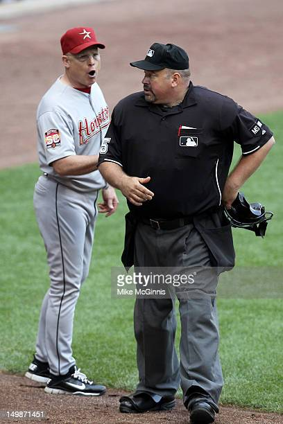 Brad Mills manager of the Houston Astros talks to home plate umpire Wally Bell during the game against the Milwaukee Brewers at Miller Park on August...