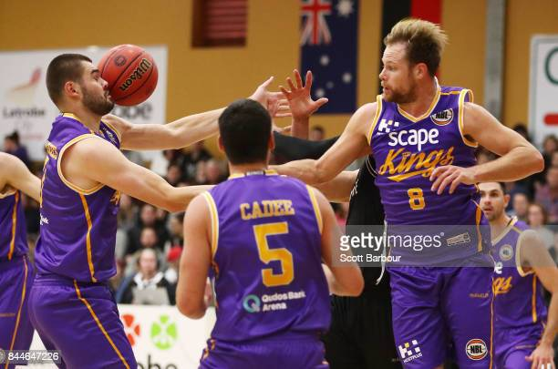 Brad Newley and Isaac Humphries of the Kings compete for the ball during the 2017 NBL Blitz preseason match between Melbourne United and the Sydney...