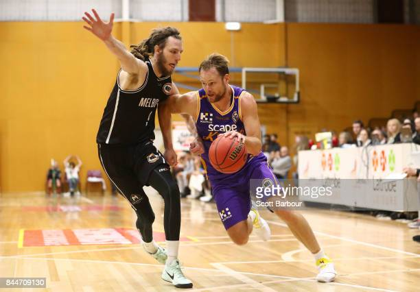 Brad Newley of the Kings and Craig Moller of United compete for the ball during the 2017 NBL Blitz preseason match between Melbourne United and the...
